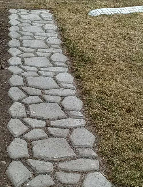 concrete paver walkway with garden edging curb